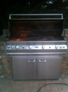 Pictured is a before image ofd a Fire Magic BBQ grill prior to the barbecue cleaning by bbq restorations of Irvine.